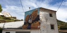 Mural mostrando oficios del pueblo de Molinicos.